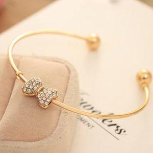 Jewelry - NEW Adjustable bow cuff bangle